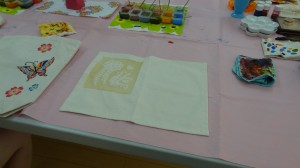 A cloth placemat with the rice-paste to allow for ease of painting.